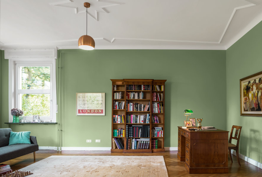 Wohnzimmer mit grüner Farbgebung – Caparol Icons